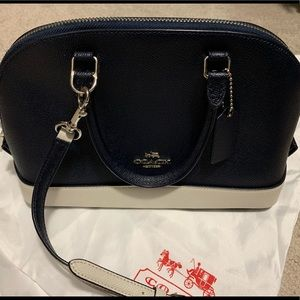 Coach small bag in navy blue with white details